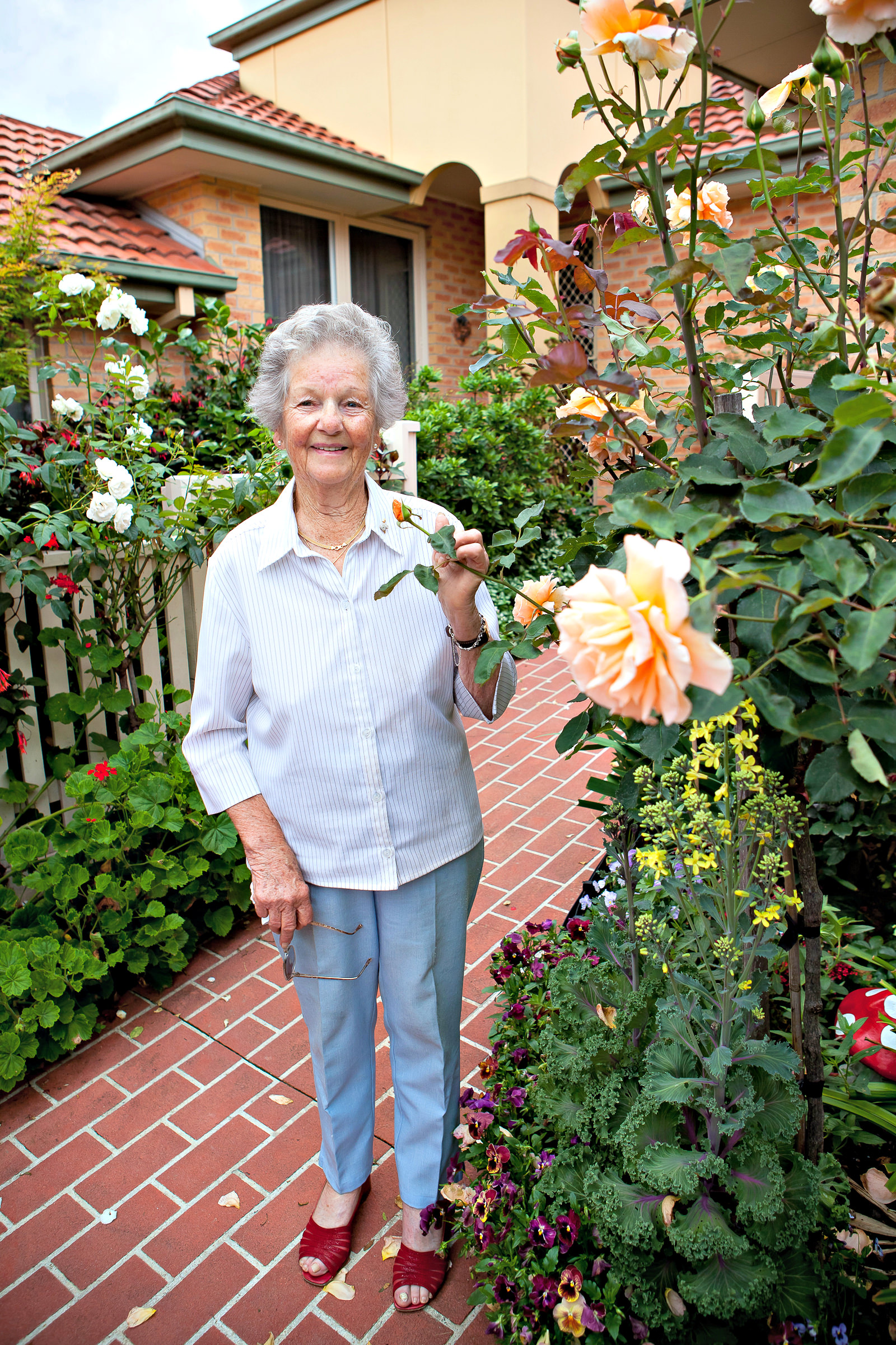 retired lady in her garden